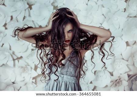 The girl aggressively looking at the camera and holding his head,fashionable toning,creative computer colors - stock photo