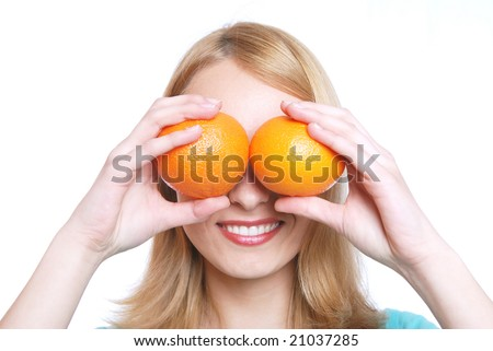 The girl and 2 oranges - stock photo