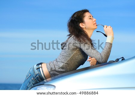 The girl and the car - stock photo