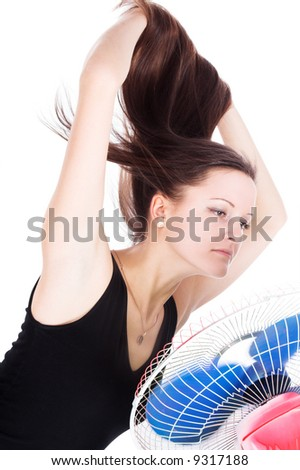 The girl and the fan on a white background