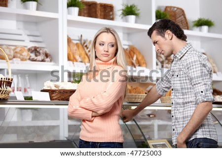 The girl and the guy in shop - stock photo