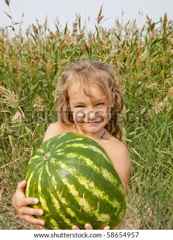 The girl and watermelon - stock photo