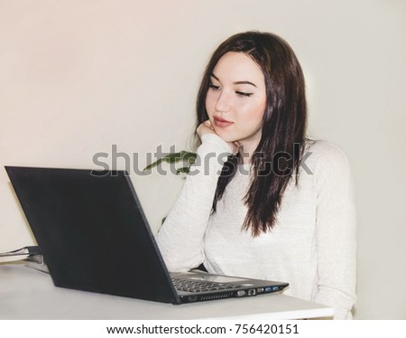 The girl at the computer. Job. A photo on a light background.