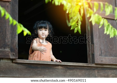 The girl at the window ,black background