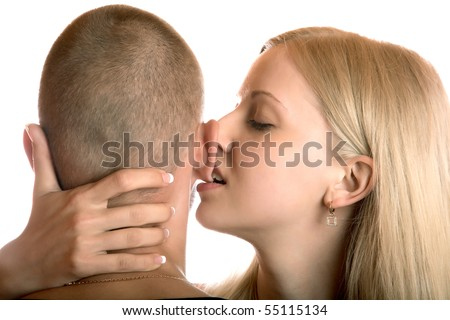 The girl bites an ear of the young man on a white background - stock photo