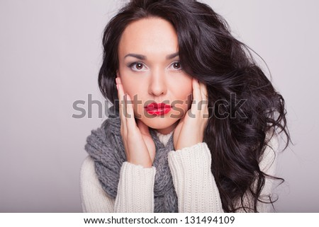 the girl close up in a warm sweater and a scarf