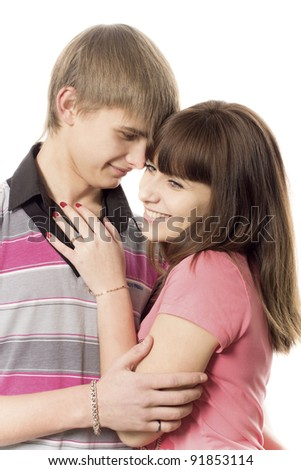 The girl costs with the guy on a white background - stock photo