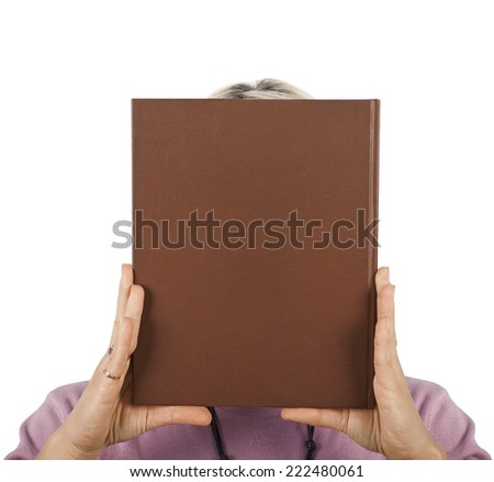 The girl covered her face with a book - stock photo