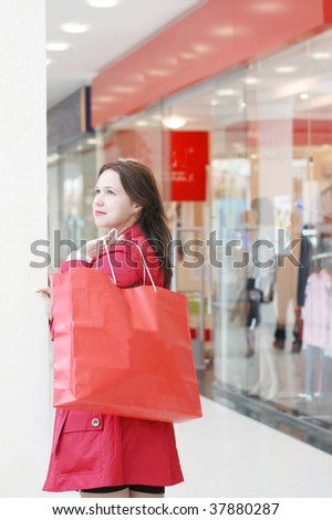 The girl doing purchase in shopping centre - stock photo