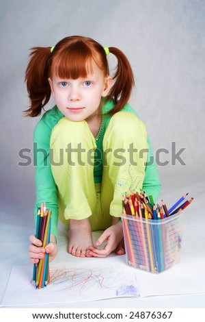 The girl draws in an album - stock photo