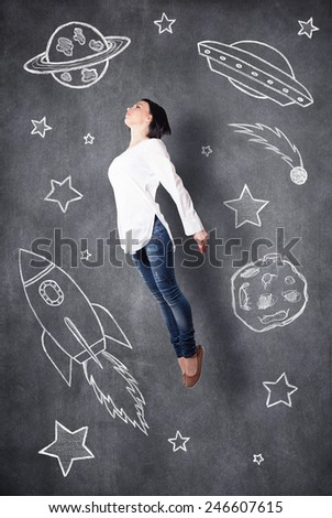 The girl dreams of cosmos in the imagination - stock photo