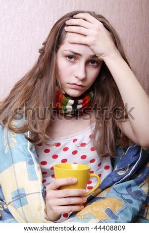The girl drinking hot tea - stock photo