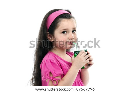 The girl drinks juice is isolated on a white background