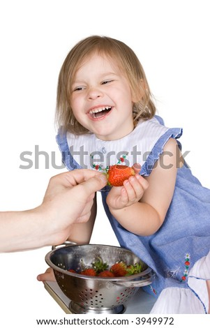 The girl eats a strawberry on an isolated background - stock photo