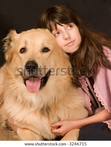 The girl embraces a dog - stock photo