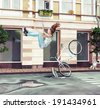 The girl falling off her bicycle on city street. Creative concept Photo compilation - stock photo