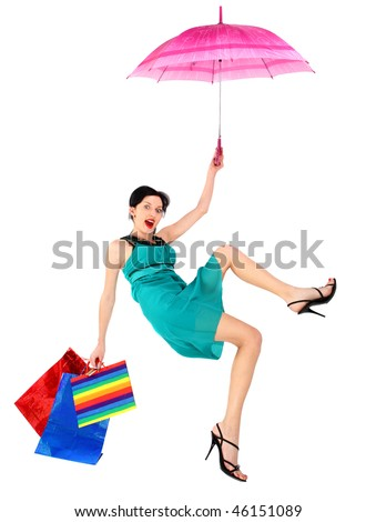 The girl fled on an umbrella. Isolated on white background - stock photo