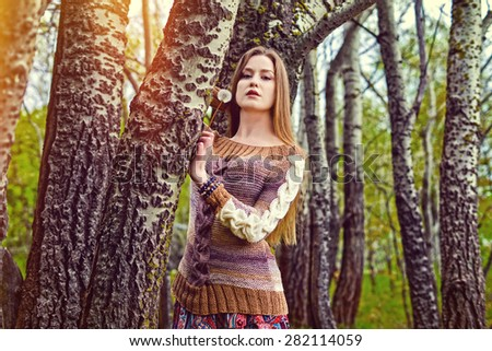 The girl got lost among big trees, a fairy forest, woman posing - stock photo