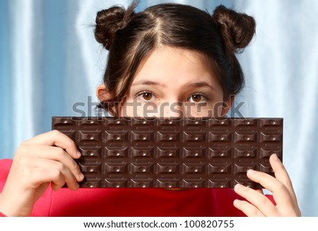 The girl has control over the big chocolate