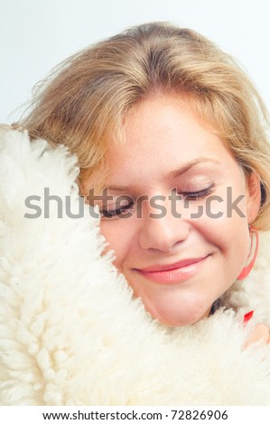 The girl has taken cover a warm sheep skin - stock photo