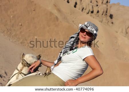 The girl has tour on camel, Egypt - stock photo