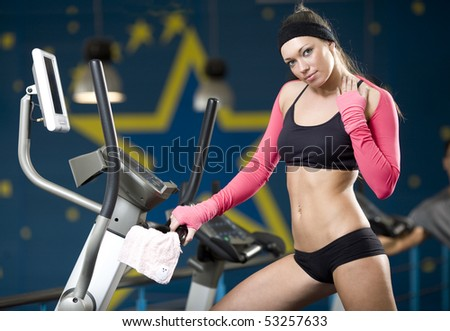 The girl holds a hand a training apparatus - stock photo