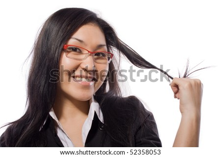 The girl holds hair a hand - stock photo