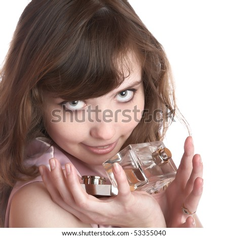 The girl holds in hands  bottle with perfume on a white background