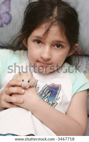 The girl holds in hands of a hamster