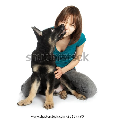 The girl holds the puppy in hands