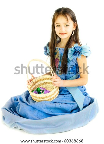 The girl in a beautiful dress with a basket