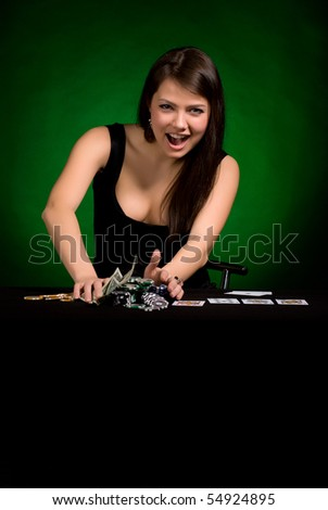 The girl in a black dress with cards on a green background - stock photo