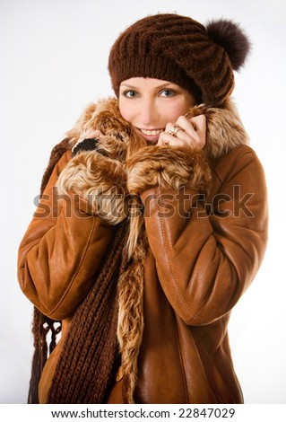 The girl in a coat keeps hands for a collar