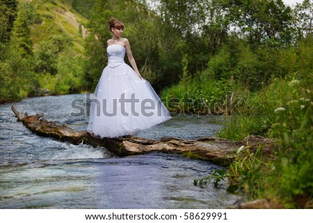 The girl in a dress in mountains - stock photo