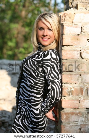 The girl in a dress of a colour of a zebra. - stock photo