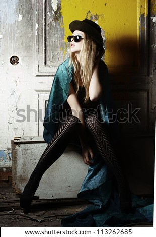 the girl in a hat and sunglasses - stock photo