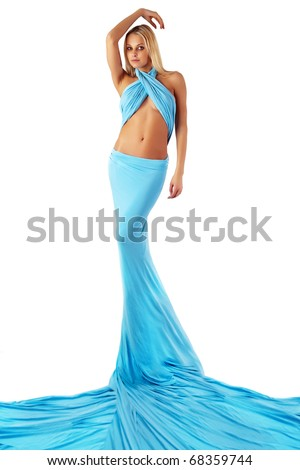 The girl in a long blue dress. - stock photo