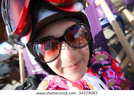 The girl in a mountain-skiing helmet and points is represented by close up - stock photo
