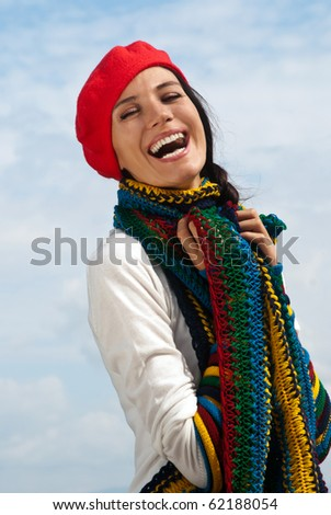 The girl in a red beret against the sky