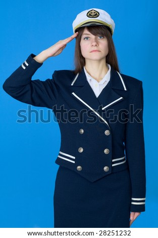 The girl in a sea uniform salutes