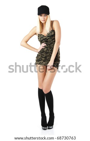 The girl in a short dress of khaki color. - stock photo