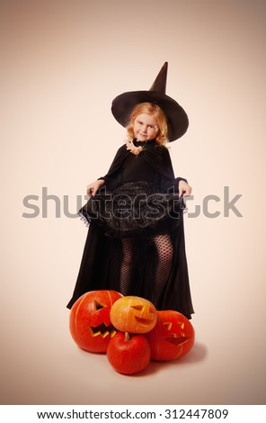 The girl in a suit of a witch - stock photo