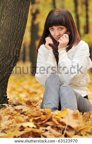 The girl in an autumn forest. The European appearance