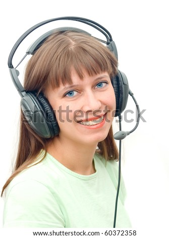 The girl in ear-phones from set - stock photo