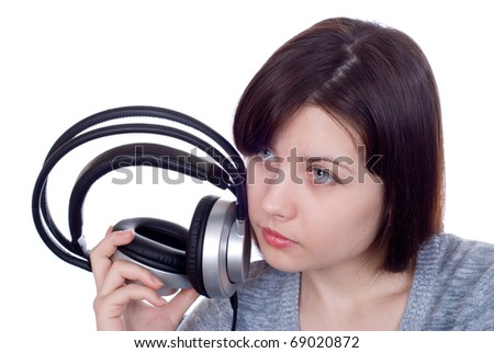 The girl in ear-phones on a white background