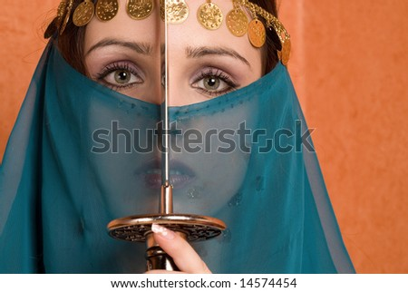 The girl in east order with a sword on an orange background - stock photo