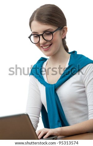 The girl in glasses with pleasure works on a computer - stock photo