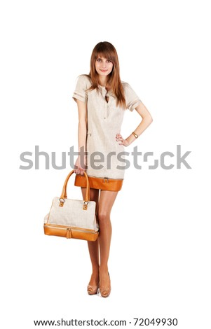 The girl in grey dress and brown bag on white background