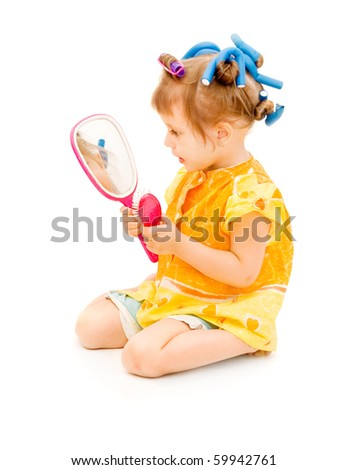 The girl in hair curlers - stock photo