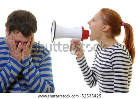 The girl in striped clothes shouts at the man in a megaphone - stock photo